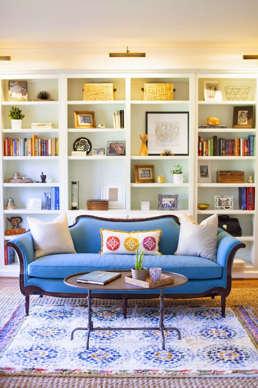 Make A Living Room A Library: Reupholstered Thrifted Blue Sofa, Layered Rugs, Painted