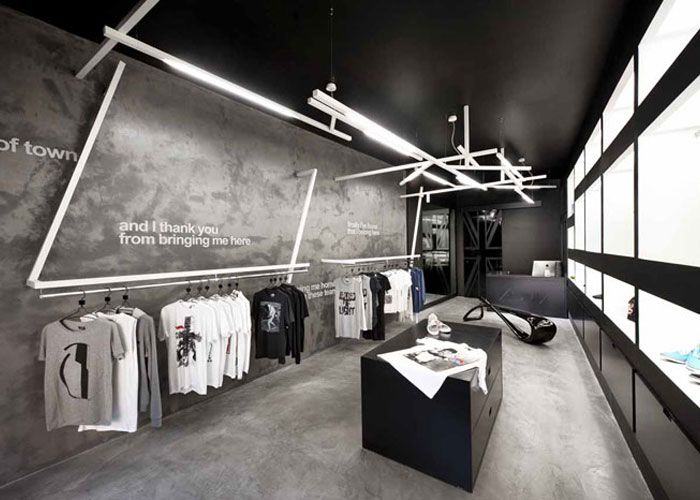 Concrete apparel store interior retail interior design for Interior design negozi