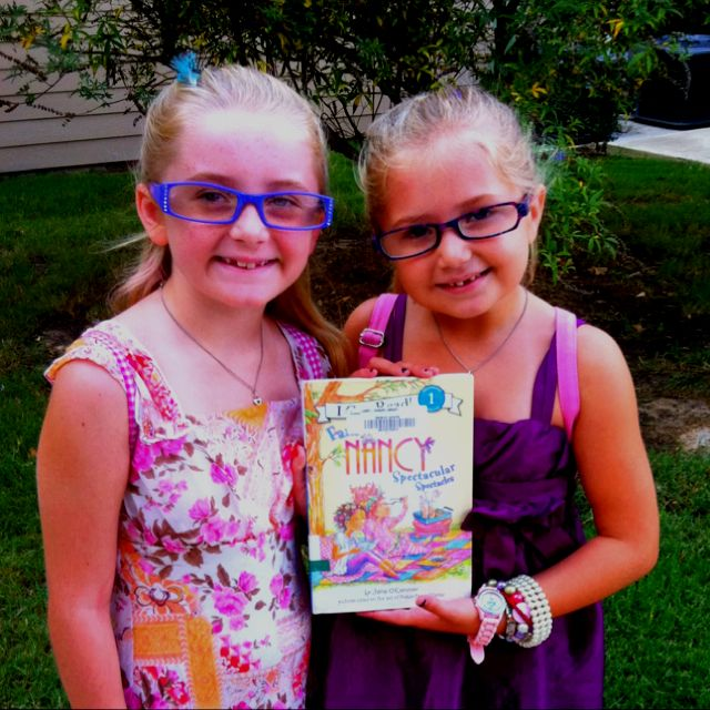 Fancy Nancy for a day!!  All dressed up with accessories & having fun in pretend Spectacular Spectacles!!    Love seeing my girls make books come to life :D