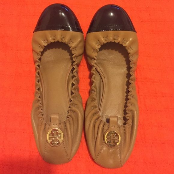 Tory Burch flats Worn a few times. Tan leather flats with black patent toe and gold Tory emblem at heel Tory Burch Shoes Flats & Loafers