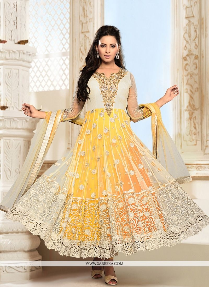 109e1f55a6d4 Make the heads flip the moment you dress up in this sort of a attractive  cream and yellow net anarkali suit. This attire is nicely designed with  embroidered ...