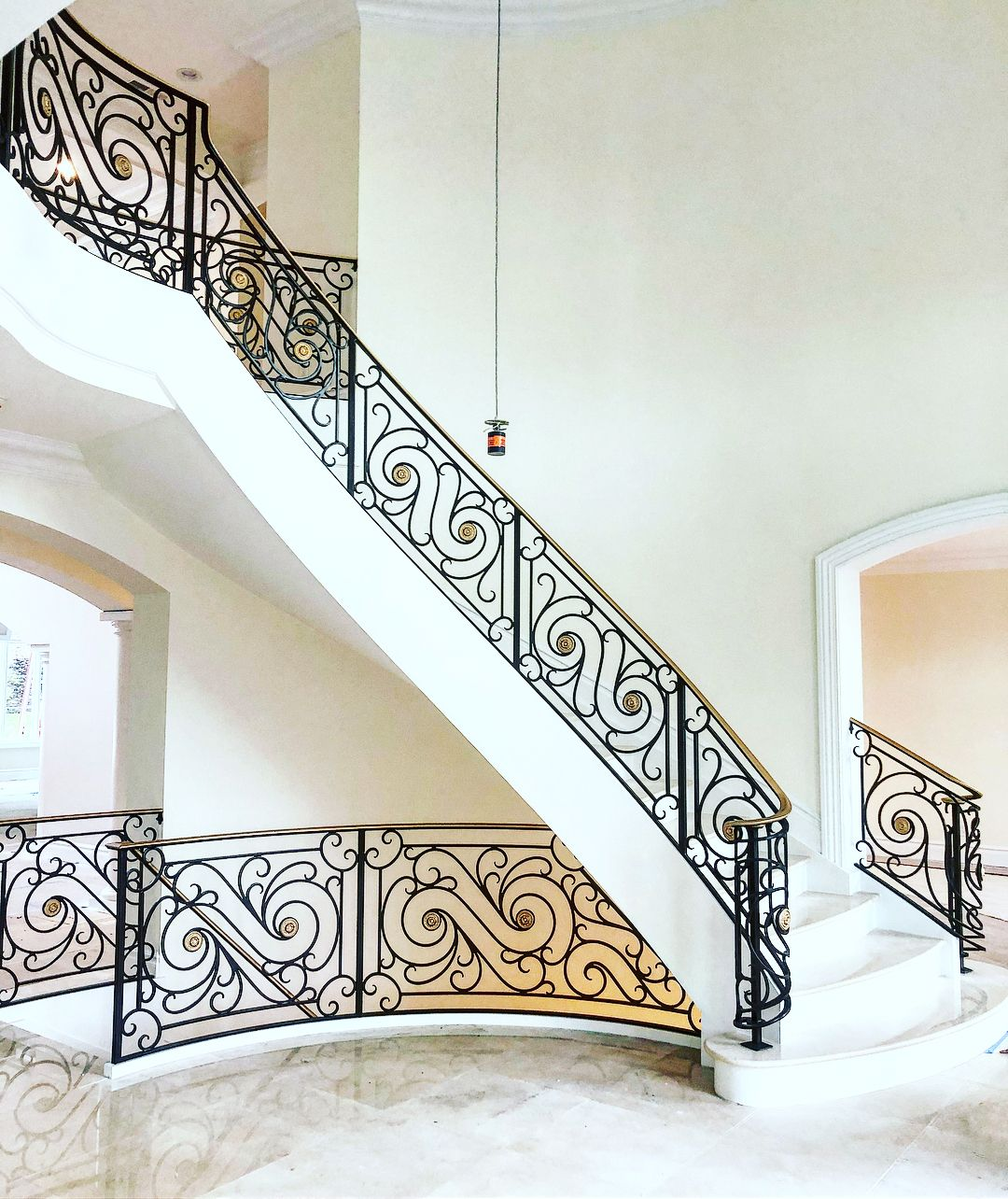 Grand Interior Iron Scroll Railing With Gold Painted Handrail And Center Medallions Ir Staircase Interior Design Wrought Iron Staircase Wrought Iron Stairs