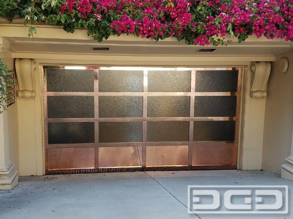 Full View Copper Garage Door With Designer Glass Panes Custom Made Garage Door For A San Francisco Ca Hom Garage Door Design Custom Garage Doors Garage Doors
