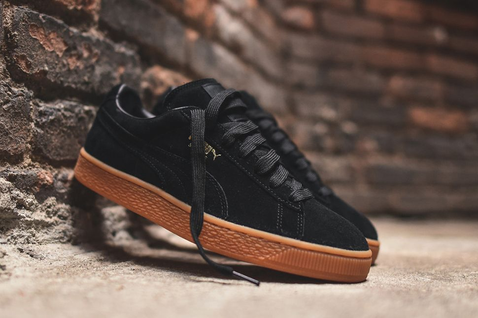 black puma with brown sole
