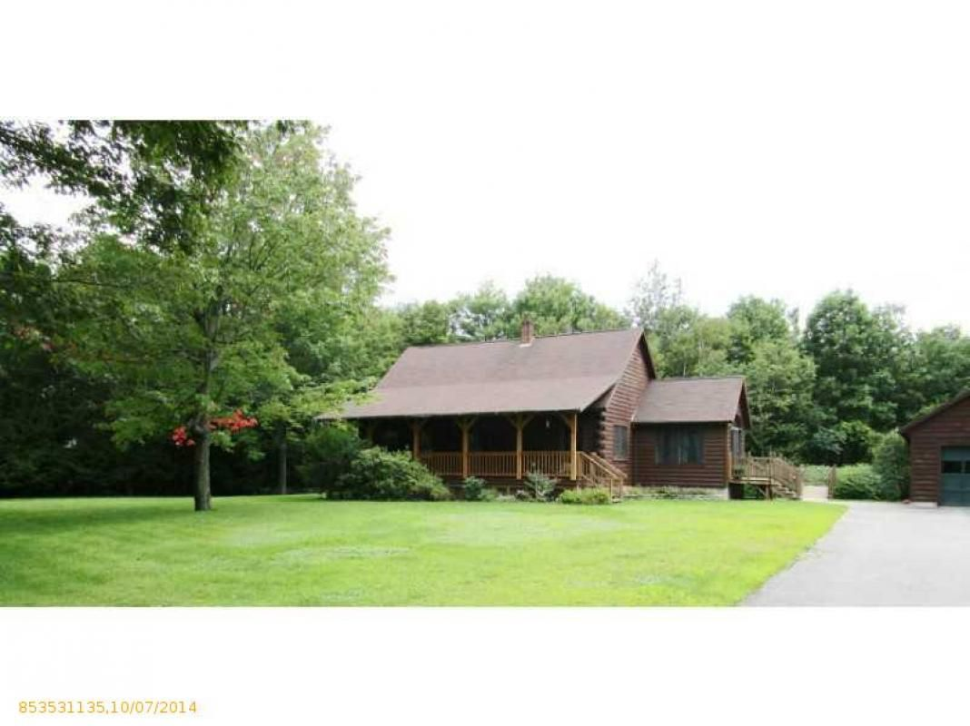 Log Home with farmers porch, country kitchen. Huge living room with ...