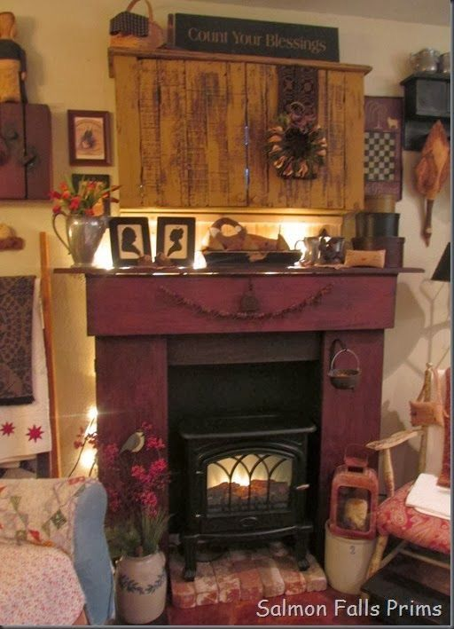 Pin by joy bennett on mantels pinterest faux fireplace mantels cabinet over fireplace to hide tv teraionfo