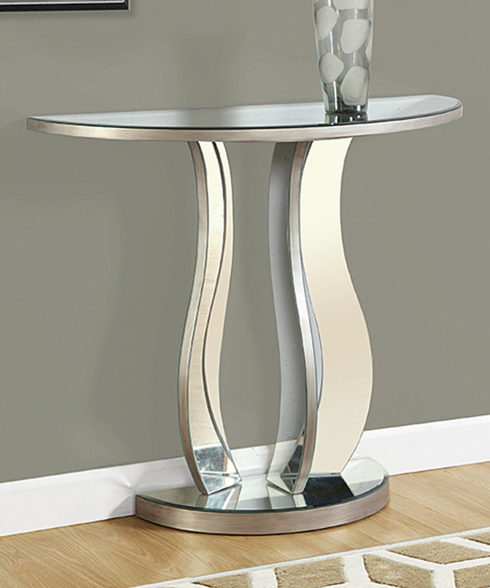 Take a look at this brushed silver mirrored console table today