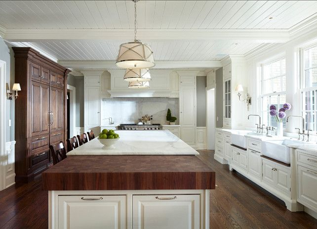 Kitchen With Large Island With Marble And Butcher Block Countertop The Butcher Block Is Made Of Wa Classic White Kitchen Island Countertops Beautiful Kitchens