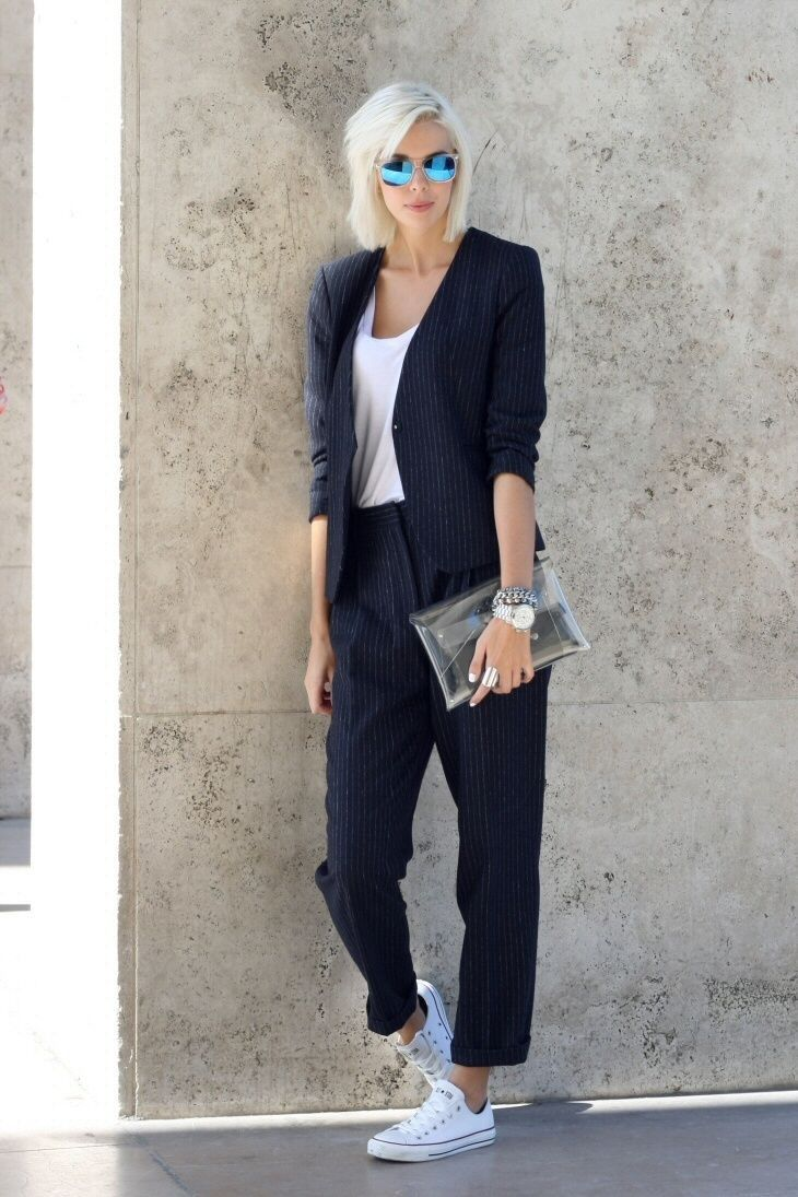Black women's suit made casual with a white tank top and a pair of white  converses