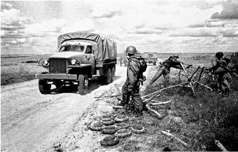 Lend-Lease. Soviet sappers clearing the road of mines and barbed wire. On the…