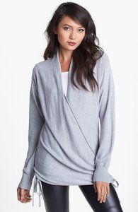 Light gray sweater that wraps over to the side and ties.  Looks great with black leather skinny pants.