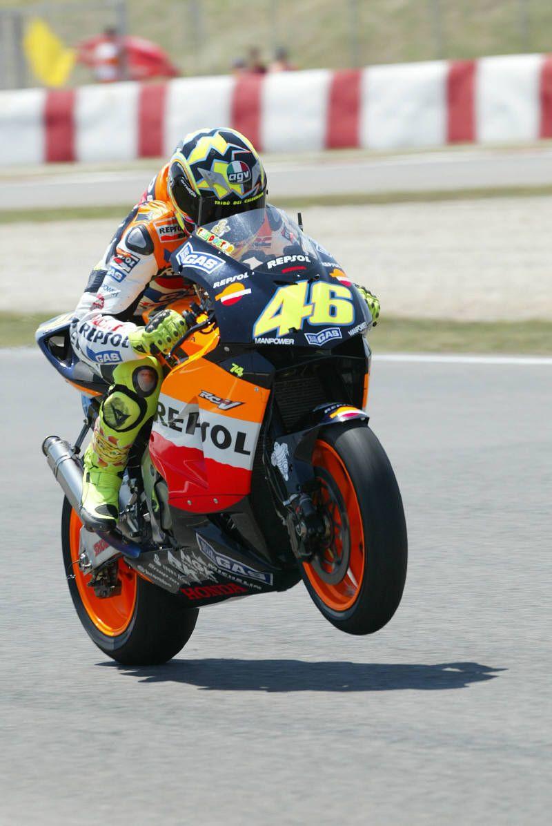 Rossi wheelies as he applies the power in Catalunya.