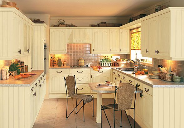 Cottage Kitchen Design cream color kitchen cabinets and slate floor | how to develop a