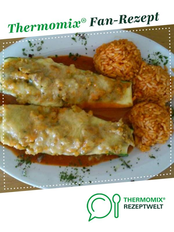 Photo of Zucchini stuffed with minced meat, rice and tomato sauce