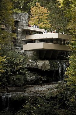 "Fallingwater or Kaufmann Residence               is a house designed by American architect Frank Lloyd Wright in 1935 in rural southwestern Pennsylvania, 50 miles southeast of Pittsburgh. The home was built partly over a waterfall on Bear Run in the Mill Run section of Stewart Township, Fayette County, Pennsylvania, in the Laurel Highlands of the Allegheny Mountains.    Hailed by Time shortly after its completion as Wright's ""most beautiful job"",[3] it is listed among Smithsonian's Life List…"