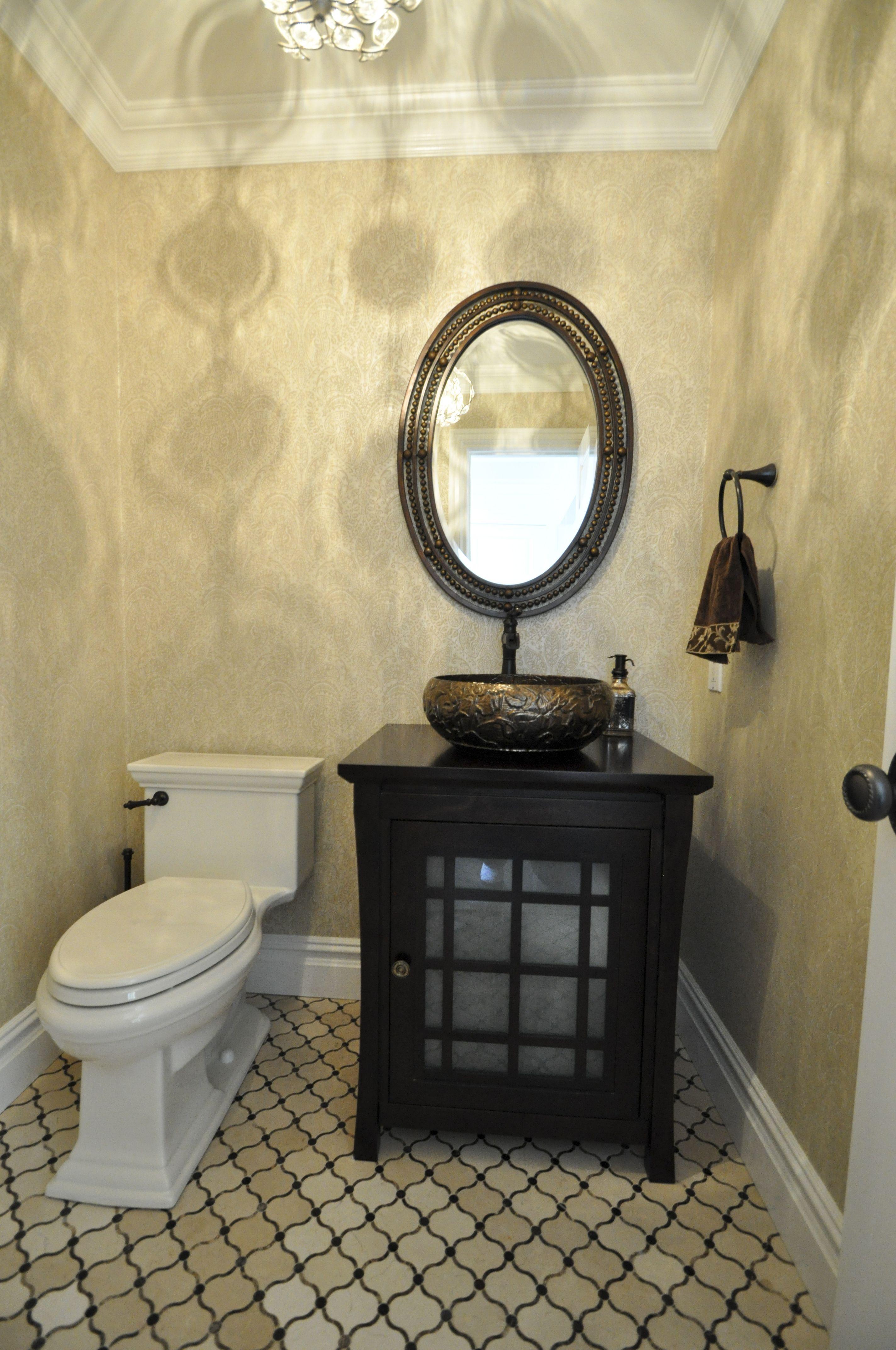 1/2 Bathroom with marble floor, wallpaper walls, single crown