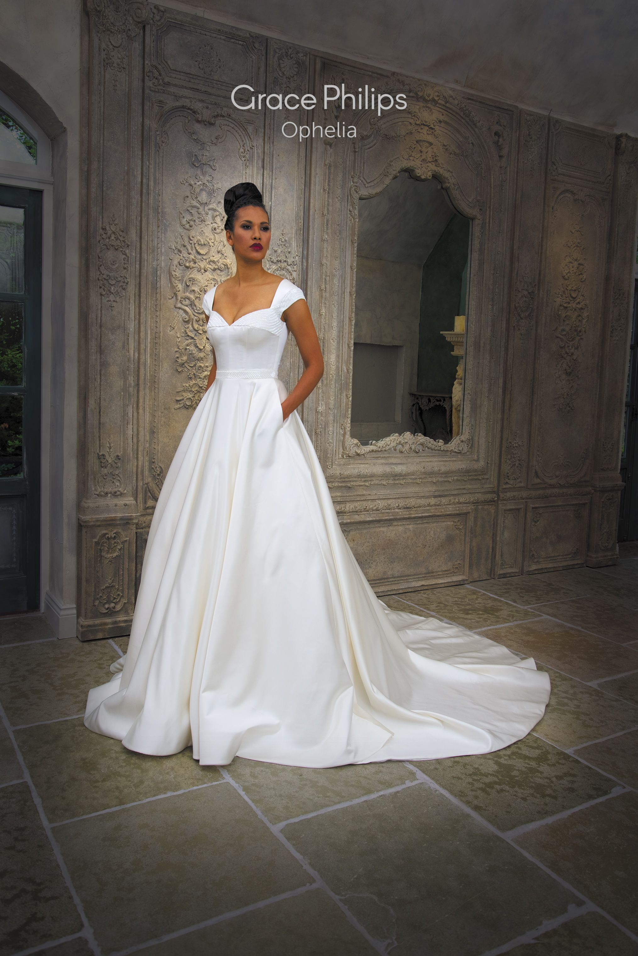 Wedding ivory dress  An ivory satin ball gown wedding dress with a soft cupid neckline