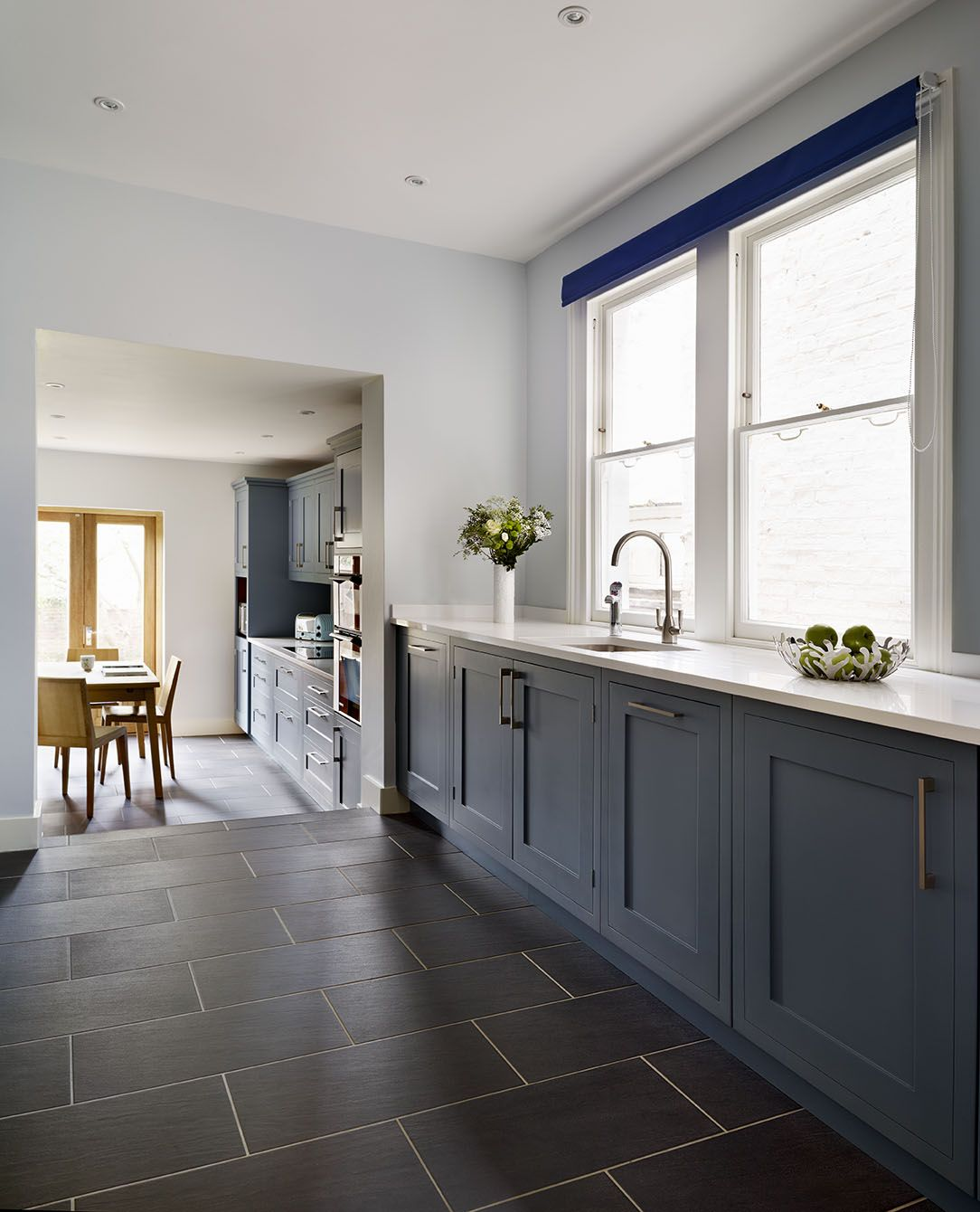 Hand Painted Dark Blue Cabinets Have Been Paired With These