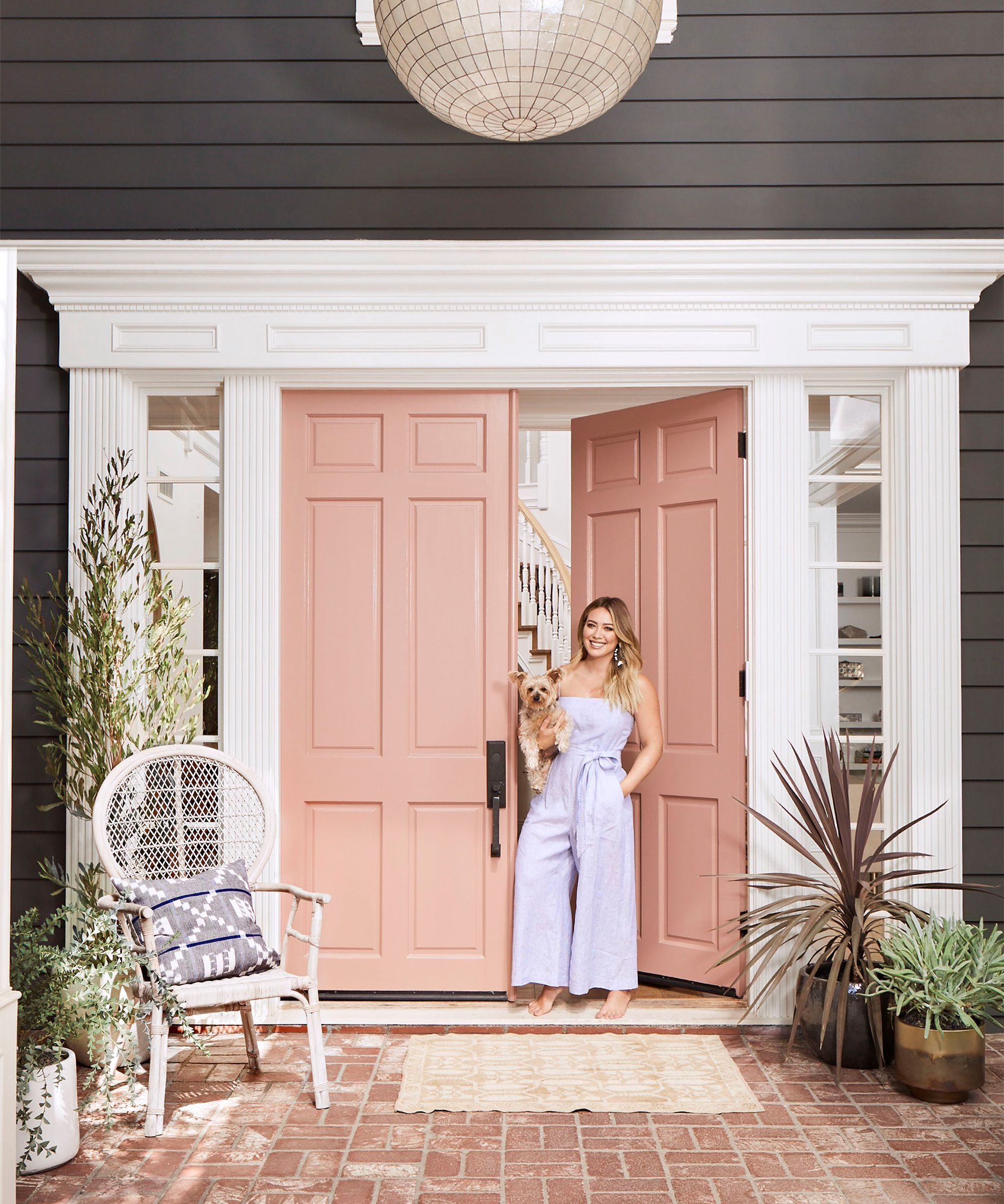 Hilary Duff Shares Her Home Decorating Style A Millennial Pink Door Is Just The Jumping Off Point Pink Front Door Pink Door Painted Front Doors