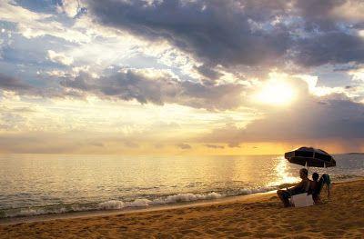 Disfrutando Del Atardecer En La Playa Uruguay American Travel Vacation Places