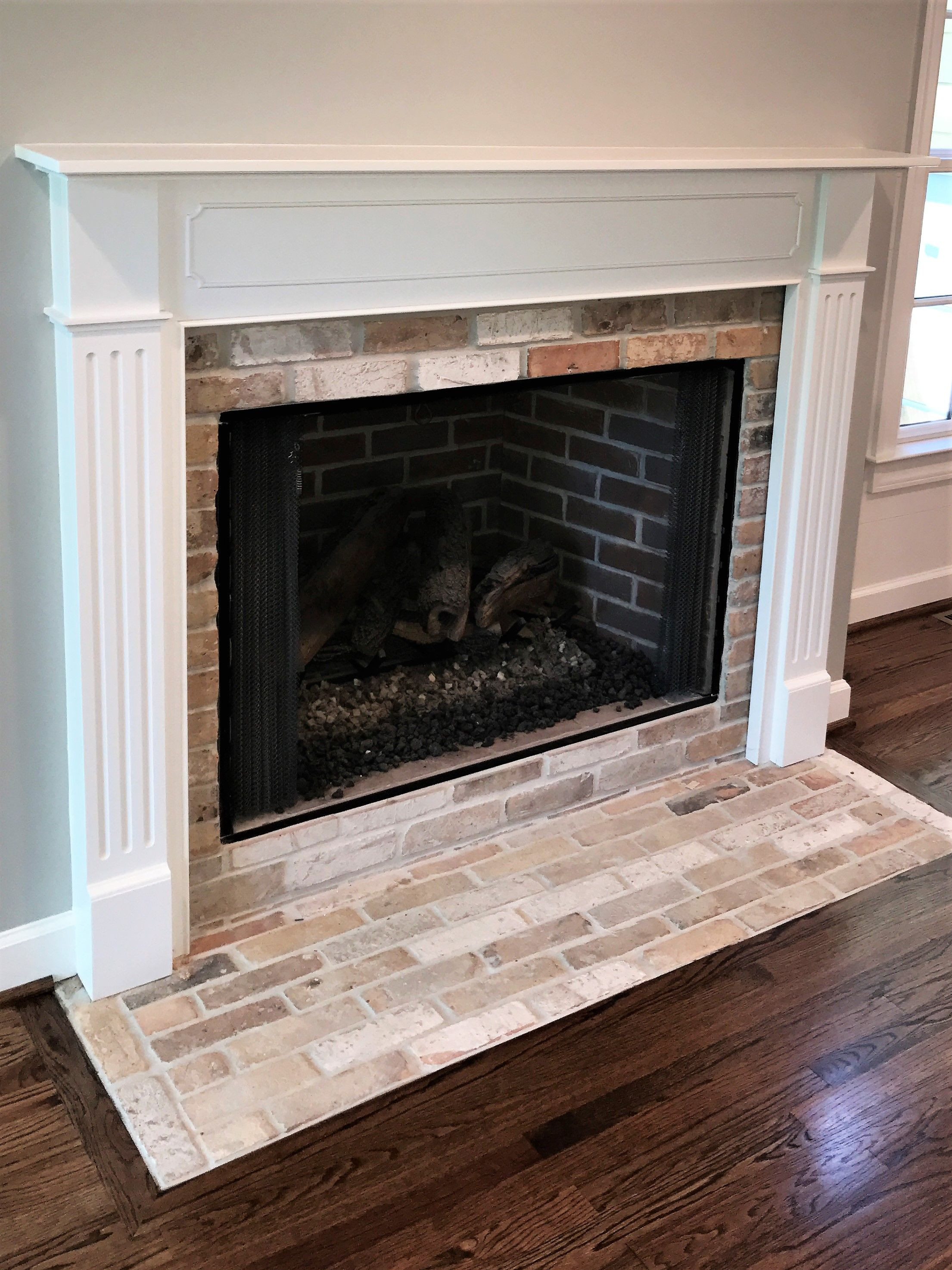 Traditional Fireplace With Reclaimed 2 X 8 Chicago Brick Hearth
