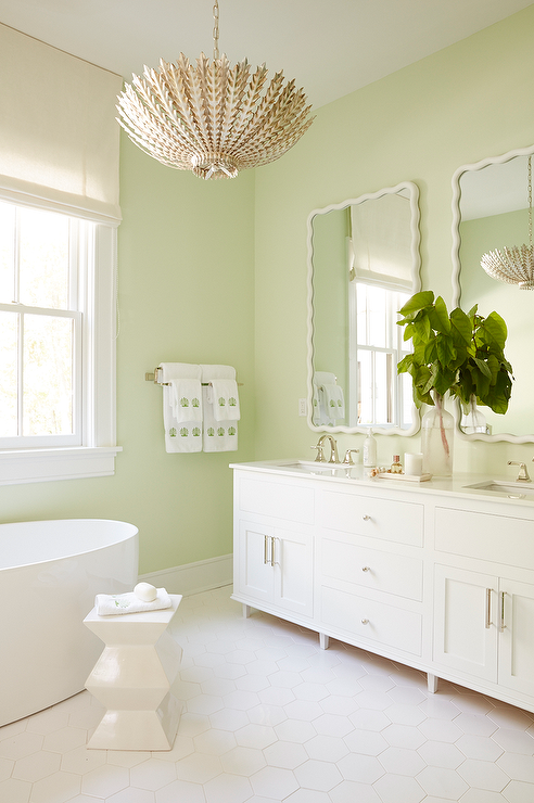 Meg Braff Designs Restful White And Green Bathroom Boasts Celery Walls Holding Two Scalloped Vanity Mirrors Over A Double Washstand