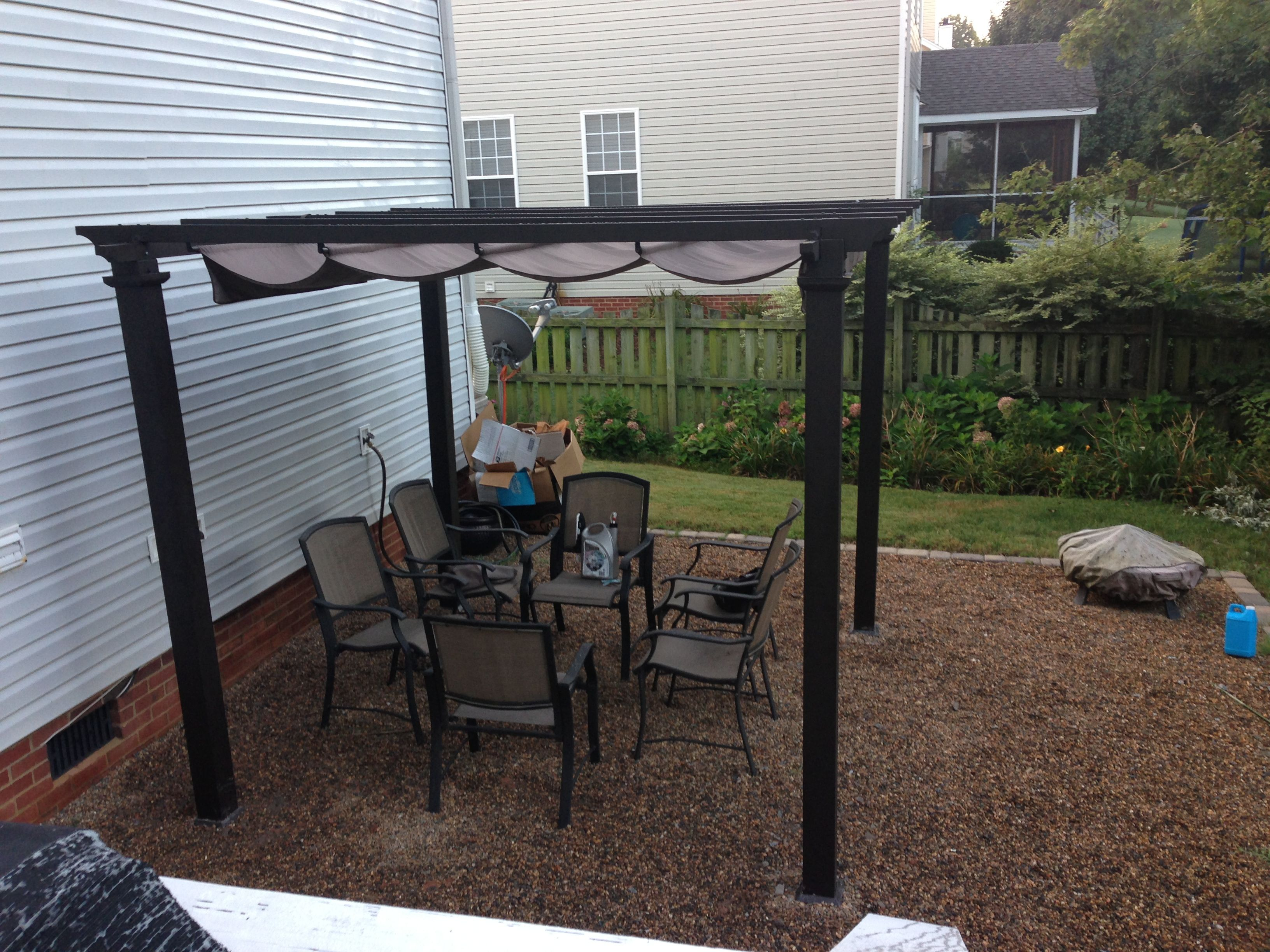Pergola from Home Depot anchored into concrete pavers buried under
