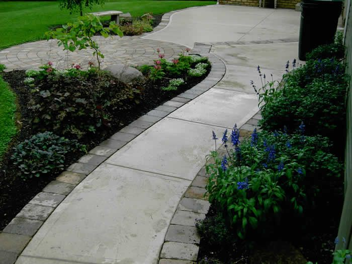 Paver border sidewalk pacific impressions backyard for Brick sidewalk edging