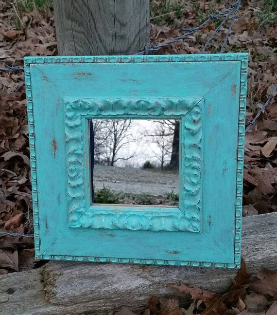 Check out this item in my Etsy shop https://www.etsy.com/listing/269197367/painted-and-distressed-aqua-mirror