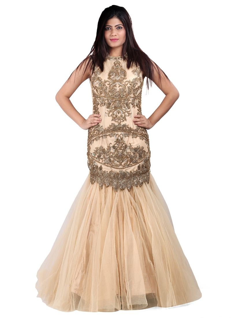 Make an adorable statement with this net designer gown. The cut dana, embroidered, kasab work, sequins work and stone work appears to be chic and excellent for party, reception and wedding. Comes with...