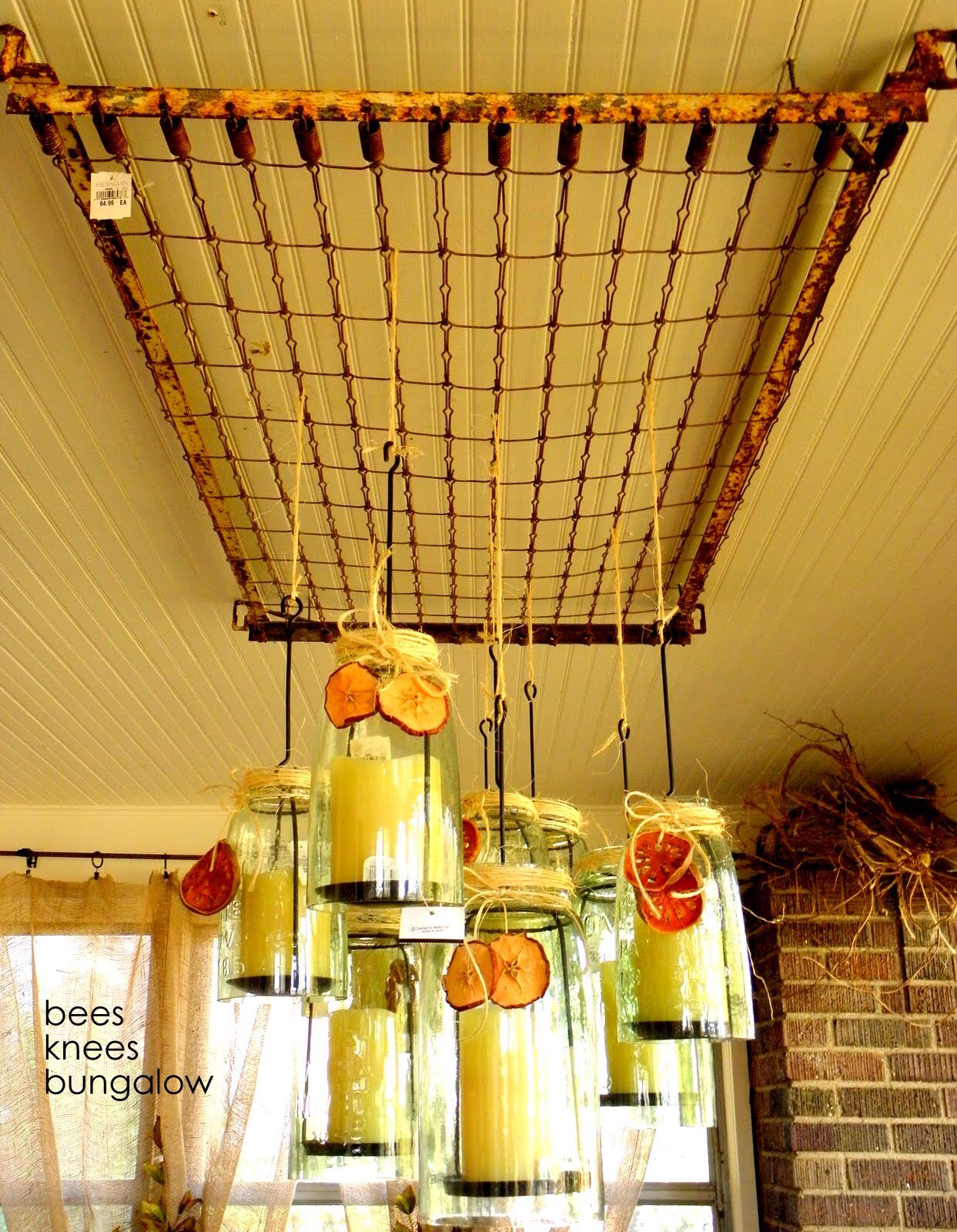 Bottomless Jars Made Into Candle Holders Hang From An Old Crib