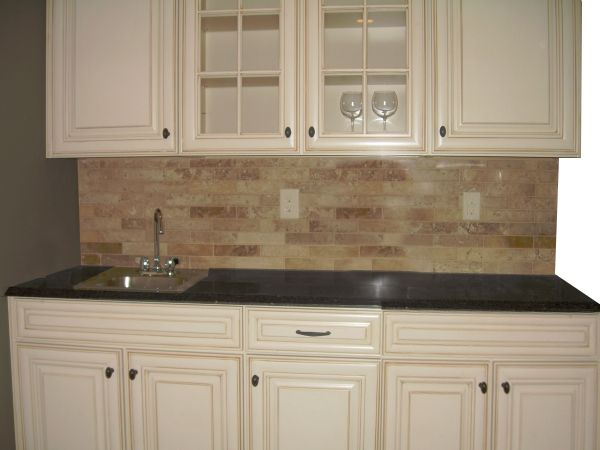 Lowes Caspian Cabinet, Grey Marble Countertop, Stone Tile Backsplash.