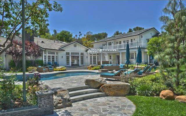 Pin for Later: Iggy Azalea Just Snagged Selena Gomez's SoCal Mansion  The swimming pool was built right next to a fire pit. Source: The Agency