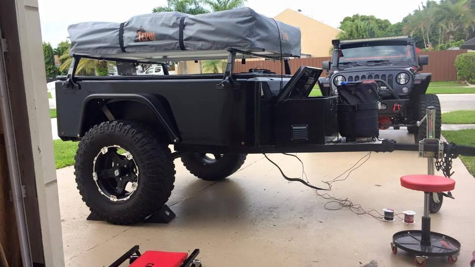 Douglas wiring up rock lights on his Jeep Trailer Jeep