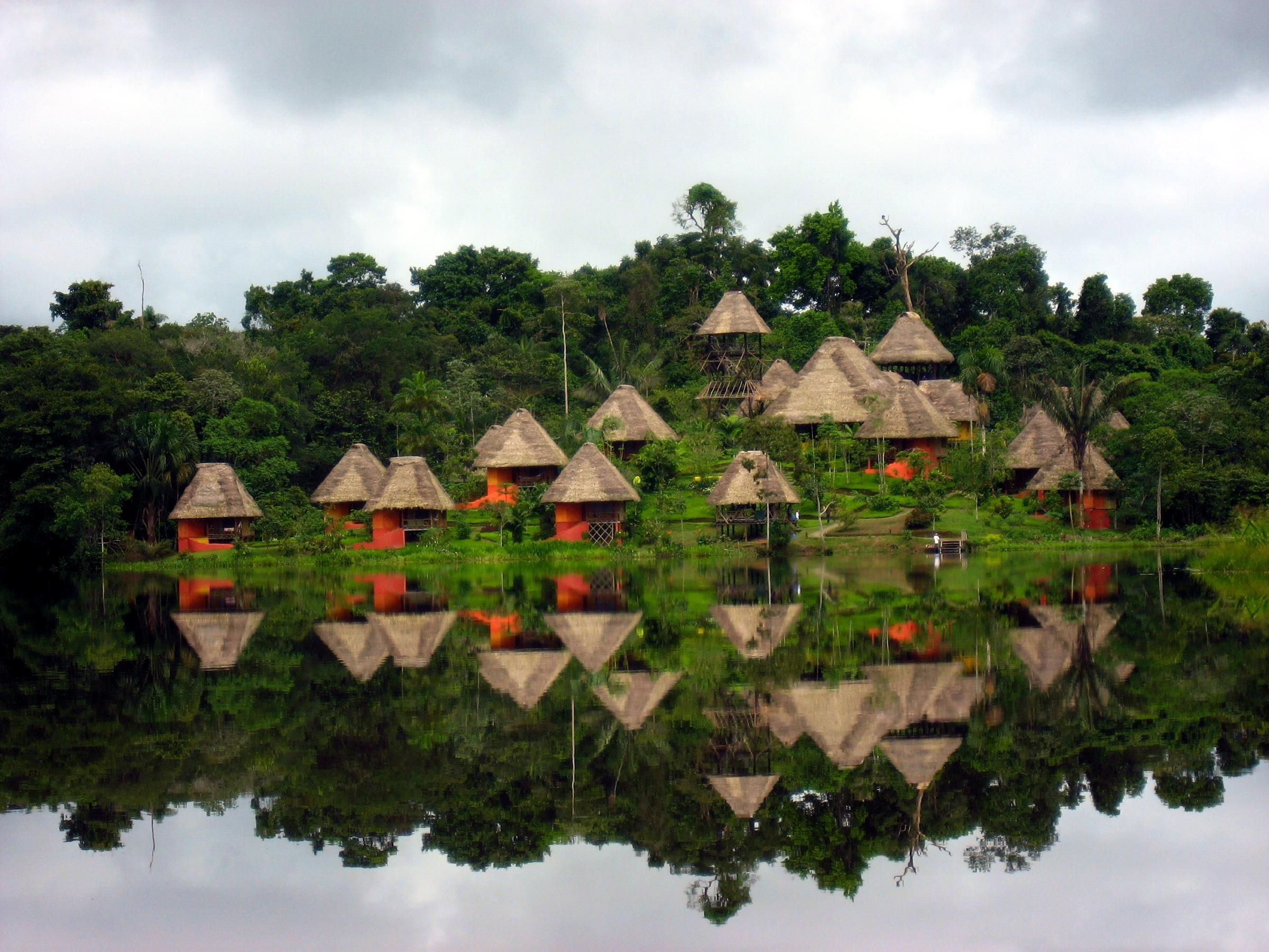 Bungalows nestled in hills of the Amazon Rainforest ...