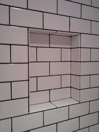 White Porcelain Subway Tiles With Black Grout For Shower
