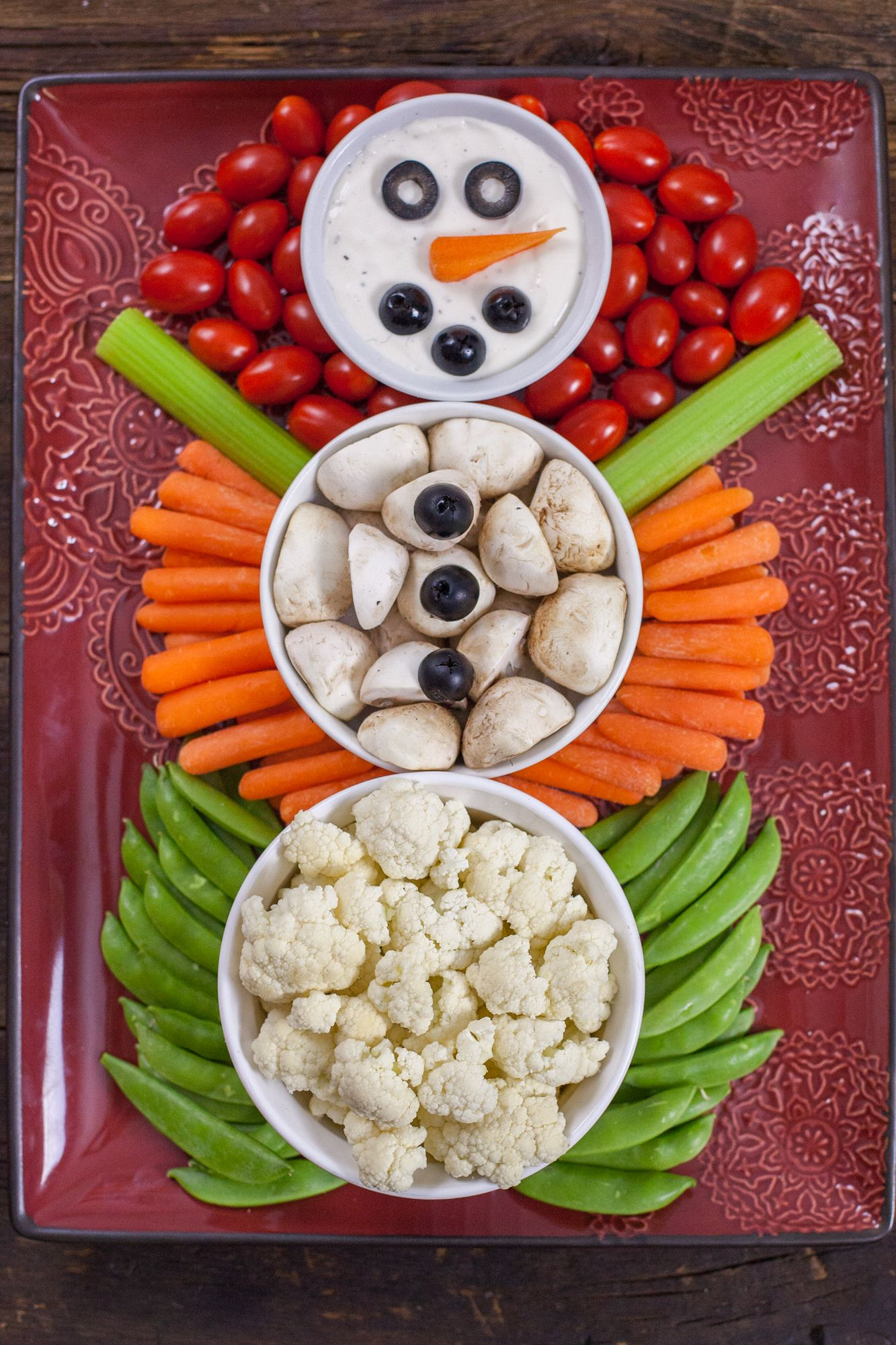 This Christmas Veggie Tray Snowman is easy enough for kids