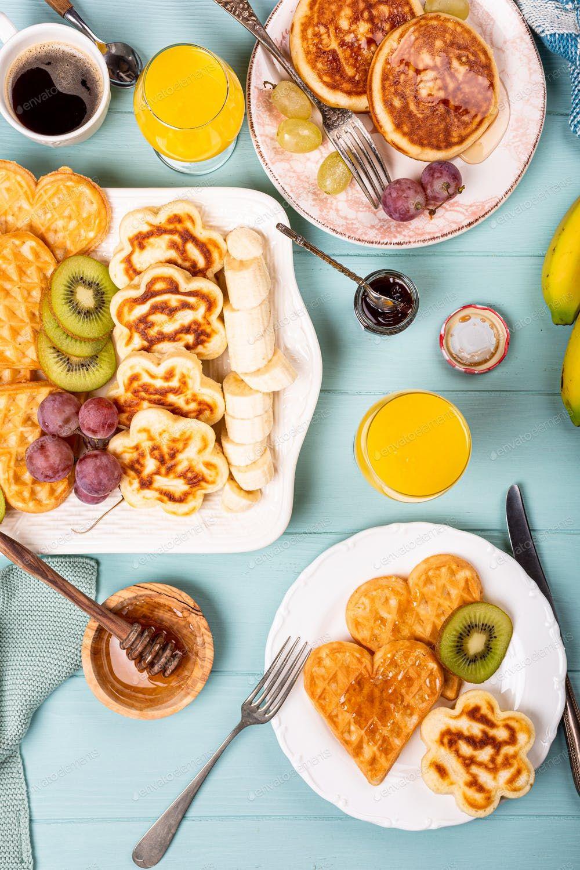 Healthy breakfast with fresh hot waffles hearts, pancakes