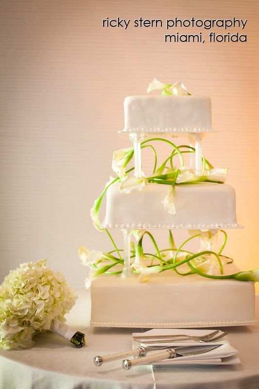 Modern, three tier square wedding cake adorned with calla lilies ...