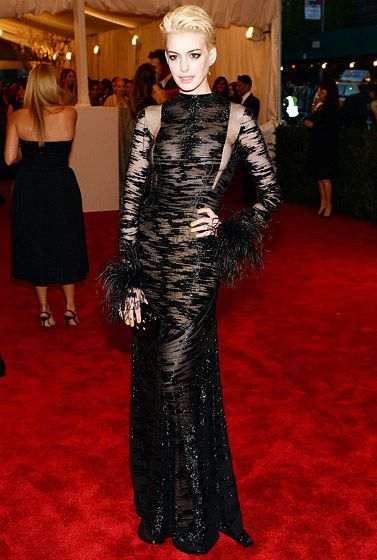 Anne Hathaway's Met Gala look: Vintage Valentino Haute Couture gown with fluid black tulle, abstract decoration, and beaded embroidery