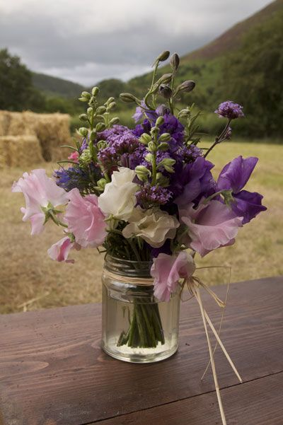 flower bouquets wedding beautiful jam jar of sweet peas verbena and delphiniums 4145