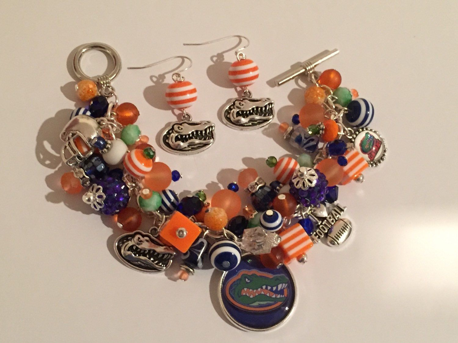 Handmade Florida Gators Charm Bracelet & Matching Earrings: Chunky Cluster Bracelet with various Orange and Blue beads by RoyalStreetBoutique on Etsy