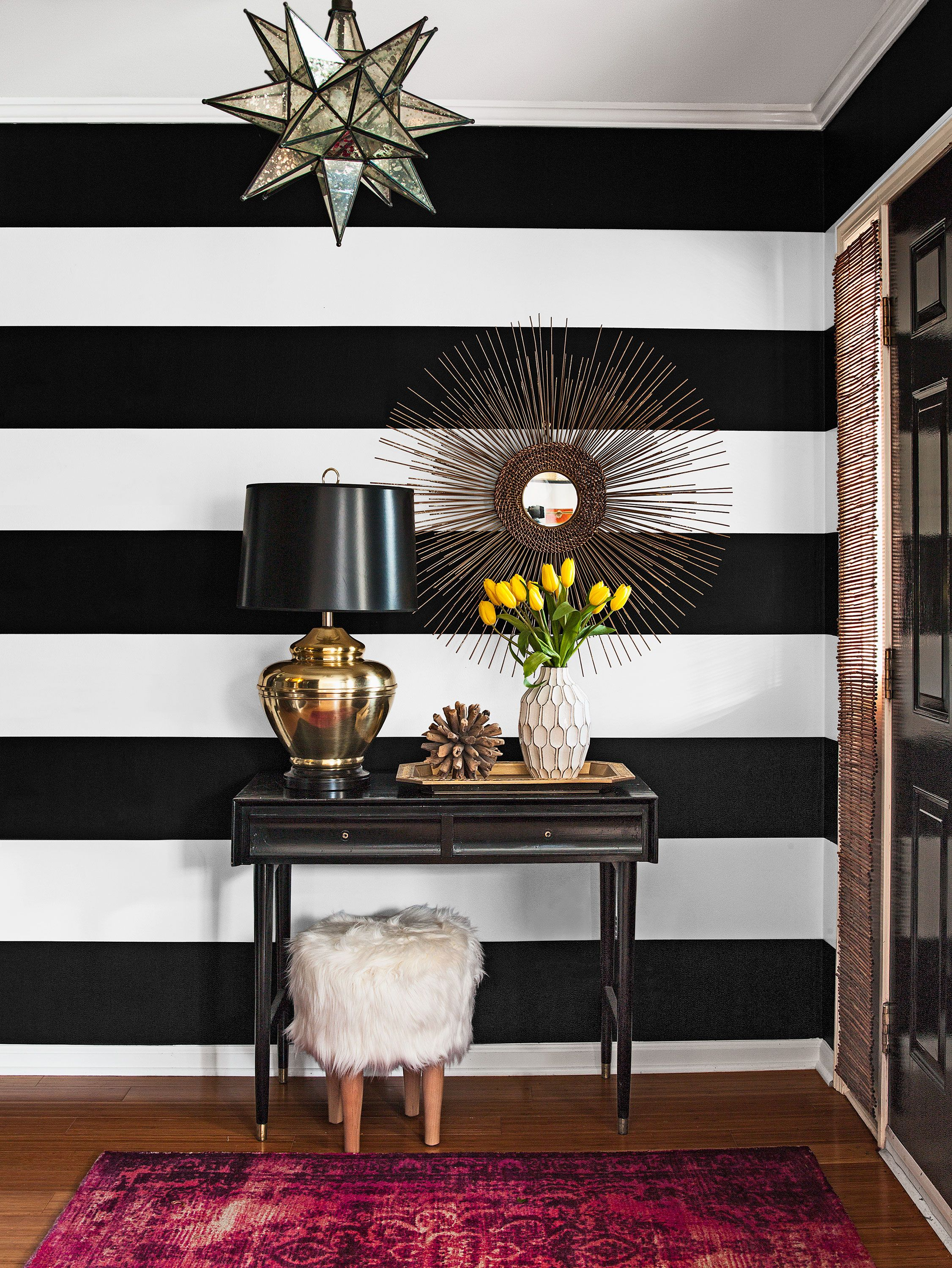 Deft Touches Of Brass And Bronze And An Eclectic Array Of Accessories Stripe Wallpaper Bedroom Wallpaper Bedroom Feature Wall Living Room Design Small Spaces