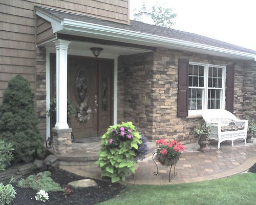 Exterior Stone Work cultured stone exterior on entryway and walls | our cultured stone