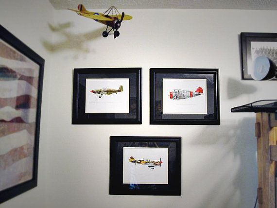 Three airplane prints in an army aviation boy's bedroom