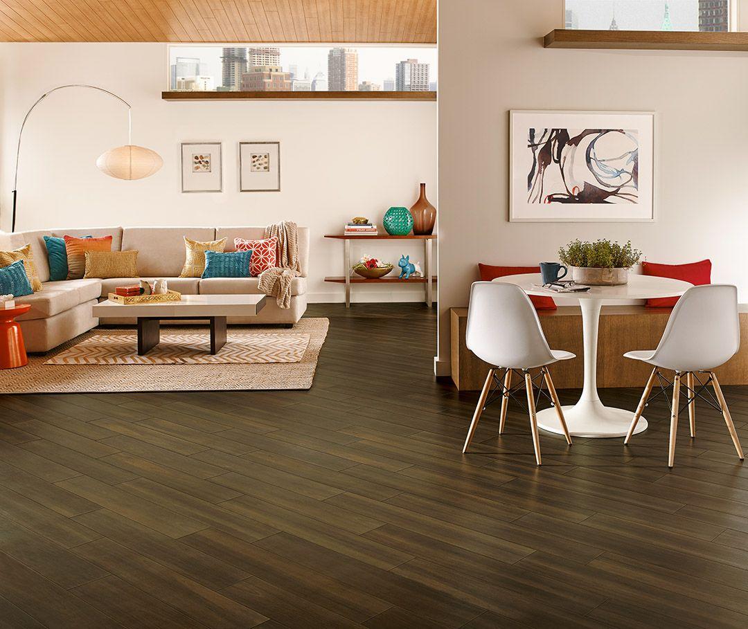 Dark flooring installed on diagonal luxury vinyl plank
