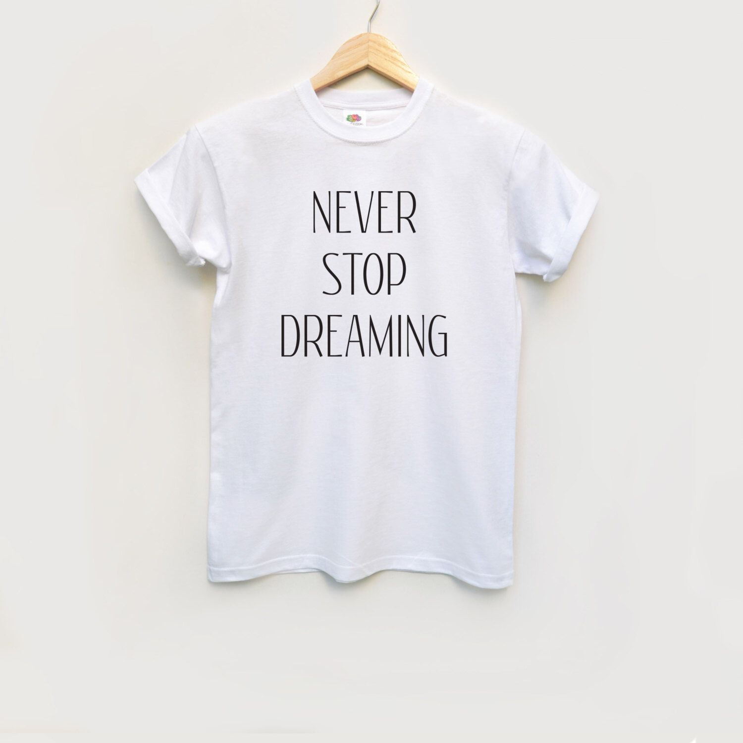 Never stop dreaming white tee shirt / Quote t shirt / White tee / Sentence t shirt / Round neck tee-shirt by fawlapparel on Etsy https://www.etsy.com/listing/483097419/never-stop-dreaming-white-tee-shirt