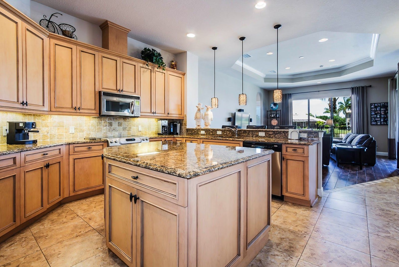Gourmet kitchen with maple glazed cabinets, stainless ...