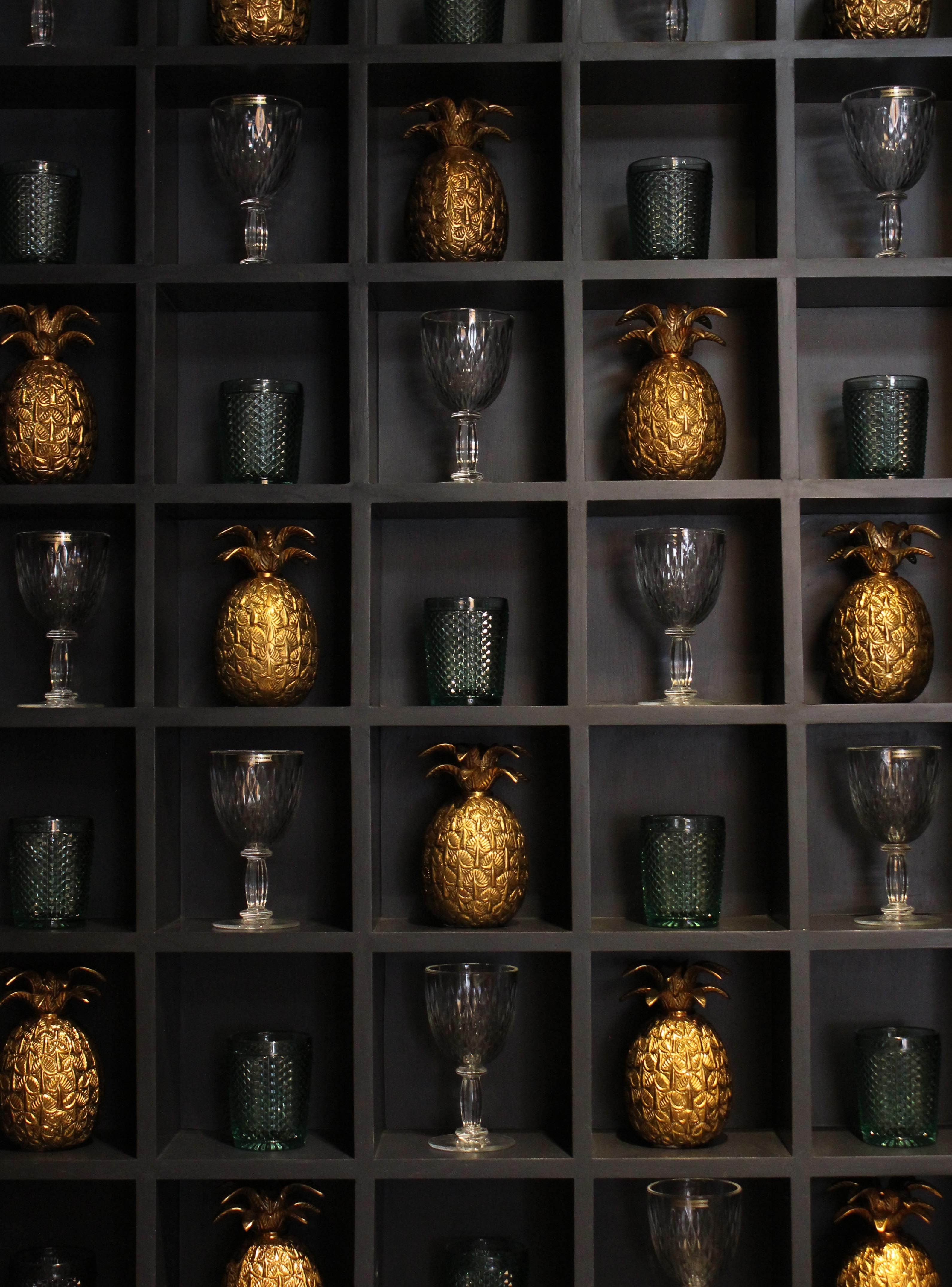 Luxury glassware and brass pineapple candle holders in our Shoreditch High St store.