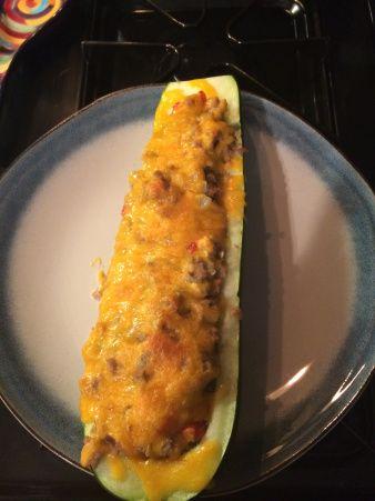 Zucchini boats w/ ground turkey, red pepper, onion, garlic, and sharp cheddar cheese from TheBoozyBonVivant.wordpress.com